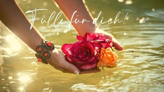 Hände mit Blumen